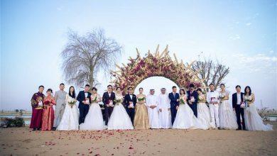 """صورة حفل زفاف جماعي صيني عند """"بحيرات الحب"""" في دبي"""