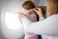 صورة طرد مسافرة مع طفلها المصاب بالتوحد من الطائرة بسبب كمامة!